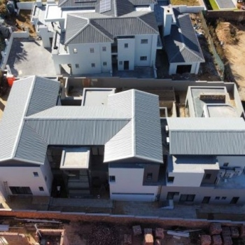 Designer-roof-truss-did-this-gleaming-gable-roof-with-IBR-sheeting-in-Waterfall-Country-Estate-Midrand004