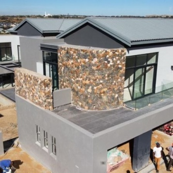 Designer-roof-truss-did-this-gleaming-gable-roof-with-IBR-sheeting-in-Waterfall-Country-Estate-Midrand005