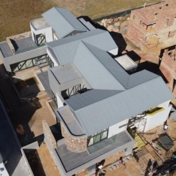 Designer-roof-truss-did-this-gleaming-gable-roof-with-IBR-sheeting-in-Waterfall-Country-Estate-Midrand007