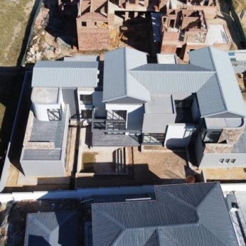 Designer-roof-truss-did-this-gleaming-gable-roof-with-IBR-sheeting-in-Waterfall-Country-Estate-Midrand008
